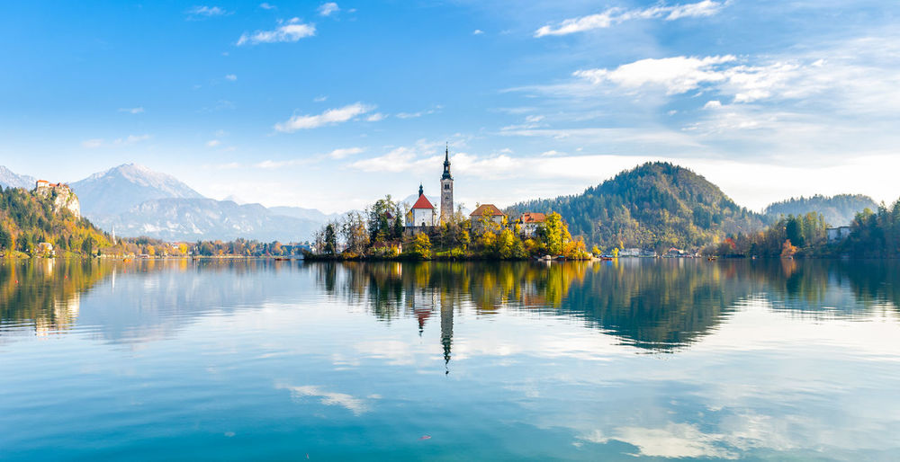 Lake Bled Slovenia. Beautiful mountain lake with small Pilgrimage Church. Most famous Slovenian lake and island Bled with Pilgrimage Church of the Assumption of Maria and reflection in calm water. Alpine Assumption Of Maria Bled Bled Island Bled Lake Slovenia Calm Church Famous Panoramic Reflection Slovenia Beautifull Colour Famous Place Fresh Water Island Lake Lake Bled, Slovenia Landmark Landscape Mountains Pilgrimage Pilgrimage Church Reflections In The Water Water
