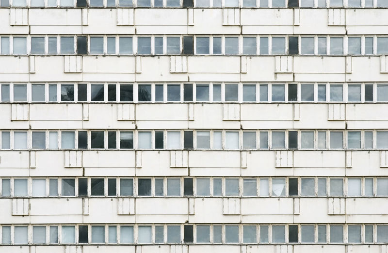 Large block of empty apartments in East Berlin, Germay Berlin Flats Plattenbau Abandoned Apartments Architecture Block Building Exterior Built Structure City Day East Berlin Full Frame Germany Housing No People Uniformity Windows