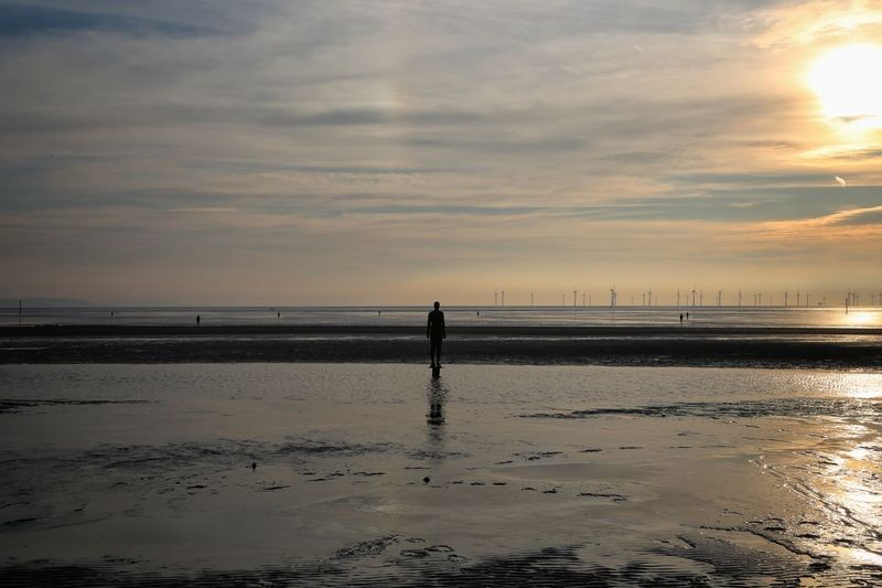 Crosby Beach Sky Scenics - Nature Water Beauty In Nature Sea Nature Crosby Beach Land Beach Cloud - Sky Sunset Silhouette Horizon Over Water Real People One Person Horizon Tranquility Standing Tranquil Scene Unrecognizable Person Outdoors