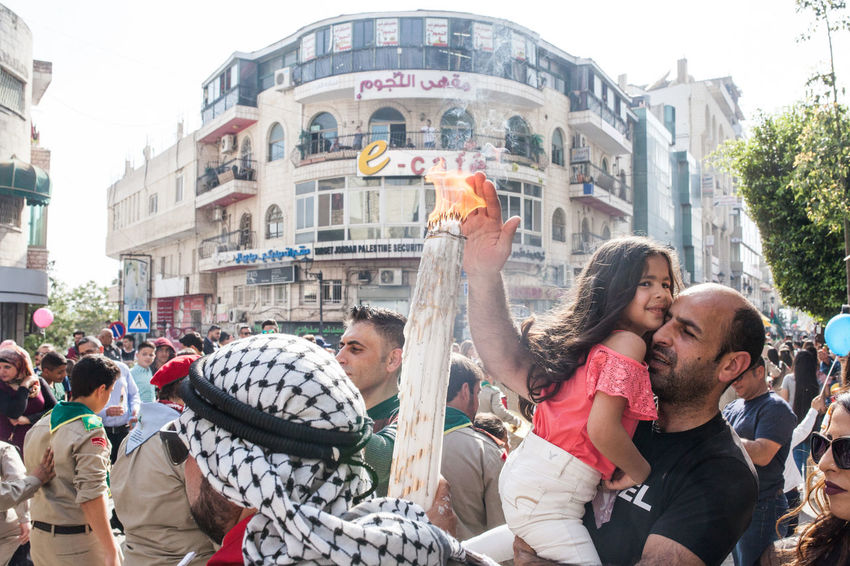 Christian Orthodox Palestinian celebrating Easter in Ramallah, Palestine. 2018. Christianity Middle East Palestine The Photojournalist - 2018 EyeEm Awards Adult Architecture Arms Raised Building Exterior Celebration City Crowd Day Enjoyment Group Of People Leisure Activity Lifestyles Men Outdoors Real People Togetherness Women