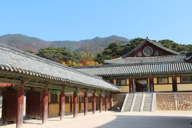 Traditional Korean buildings at the Bulguksa temple with the beautiful surrounding in autumn, Gyeongju, South Korea Autumn Gyeongju, Korea Korean Traditional Architecture Roof South Korea Sunny Architecture Building Exterior Built Structure Bulguksa Clear Sky Day Mountain Moutain No People Outdoors Sky Sunlight And Shadow
