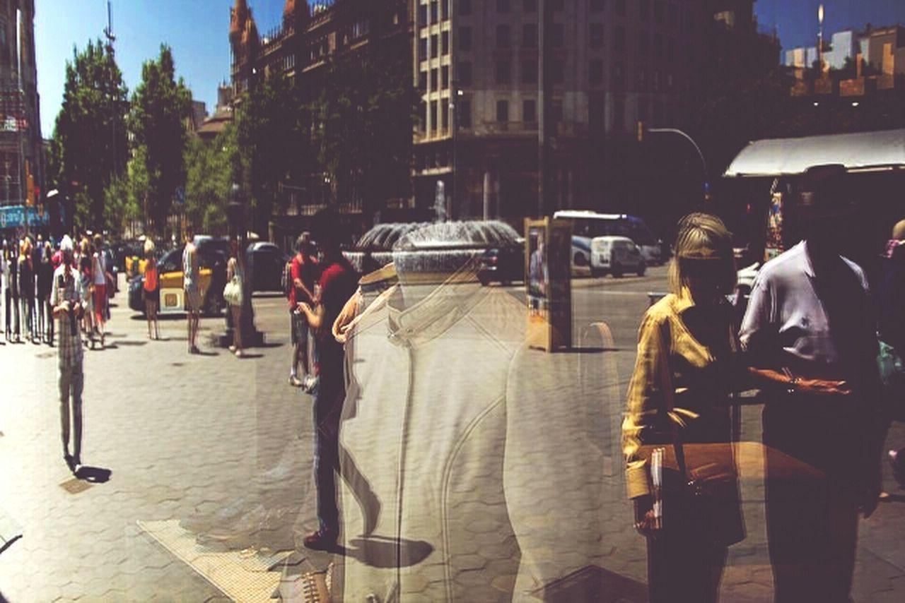 WOMAN STANDING ON CITY STREET