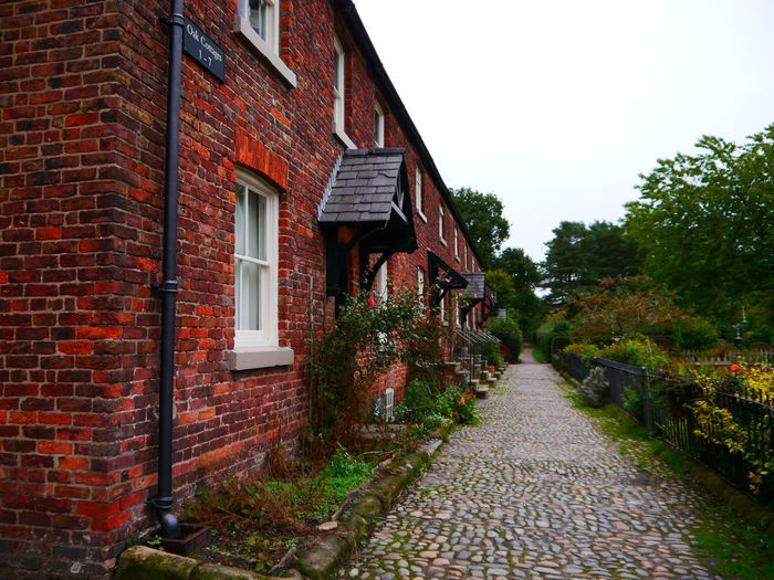 Quarry Bank Mill Architecture Building Exterior Built Structure Building Plant Footpath House No People Nature Sky The Way Forward Tree Residential District City Outdoors Day Direction Street Brick Wall