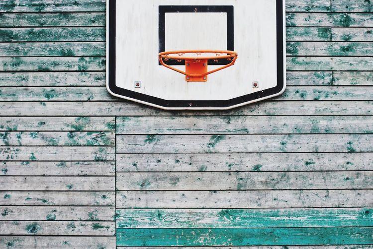 Basketball hoop on wooden wall