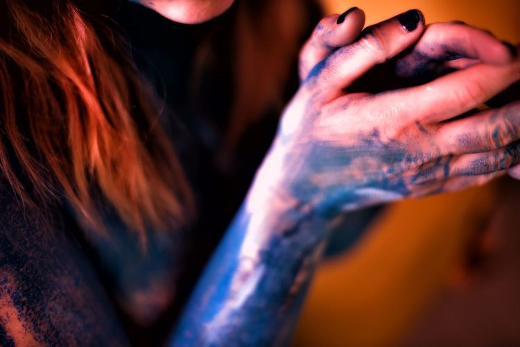 Midsection of woman with powder paint on hands