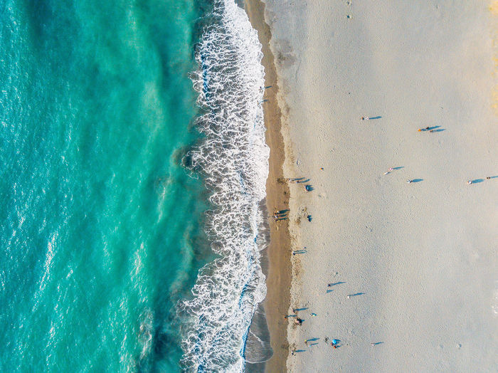Aquatic Sport Beach Beauty In Nature Day High Angle View Land Motion Nature Outdoors Sand Scenics - Nature Sea Sport Surfing Tranquility Turquoise Colored Water Wave The Great Outdoors - 2018 EyeEm Awards
