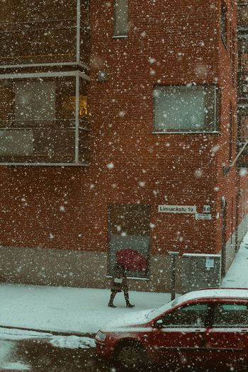 One Woman Only Girl Snowing Snowfall City Street Street Portrait Street Photography Real People Snow Cold Temperature Winter Architecture Built Structure Building Exterior Snowing City Day Street Outdoors Blizzard It's About The Journey