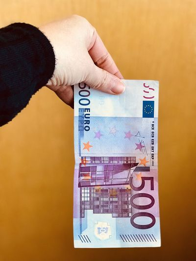 Euro Money Cash Human Hand One Person Finance Paper Currency Indoors  Real People Human Body Part Holding Currency Close-up Savings Wealth Day People