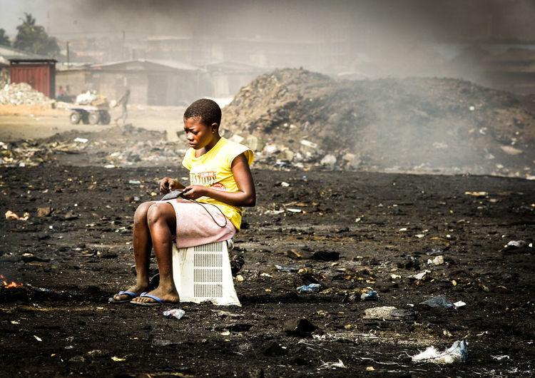 Abogbloshi Africa African Burning Electrical Scrap Electronics  Elektroschrott Fire Ghana Hard Work Hardship Healthy Eating Loneliness Lonely Misery Monitor Müllkippe One Person One Woman Only Outdoors Poison Pollution Raw Materials Recources Young Women EyeEmNewHere EyeEmNewHere The Photojournalist