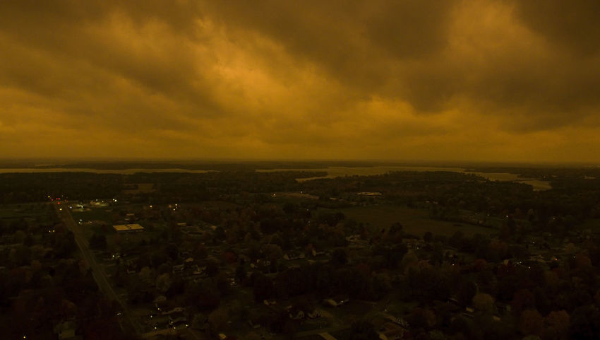 A strange orange cast goes over the southern Illinois landscape before a storm begins on a warm Fall day. Drone  Illinois Storm Stormy Weather Weather Aerial Aerial View Clouds Clouds And Sky End Of The World Lake Landscape Nature No People Orange Color Outdoors Sky Stormy Sunset Water
