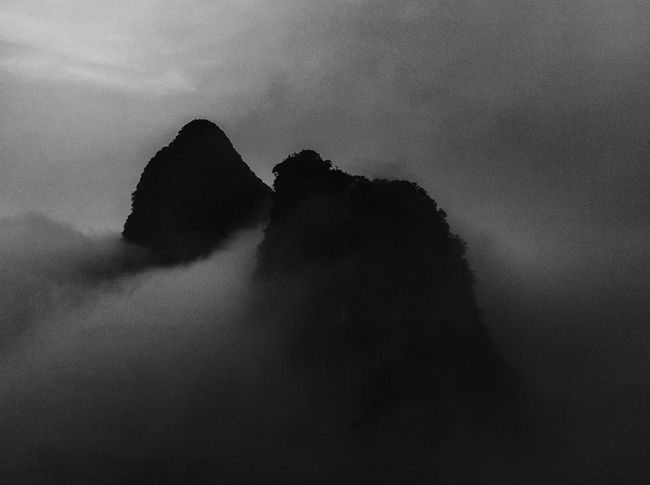 Low Key Morning Travel Photography Beauty In Nature Clouds Dawn Day Fog Nature No People Outdoors Scenics Silhouette Sky Sunrise Sunrise Above The Clouds Tourism Tourist Destination Tranquility Black And White Monochrome Monday Morning Monochrome Monday Black And White Friday