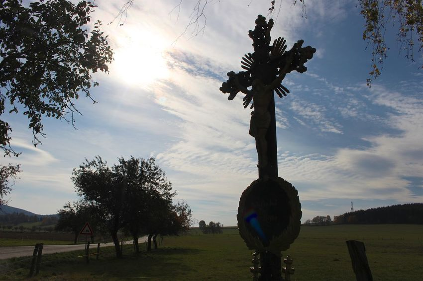 The cross by the side of the road Cloud Cloud - Sky Cloudscape Countryroads Cross Jesus Jesus Christ Low Angle View Outline Religion Religous Silhouette Sky Spiritual Sun Tree