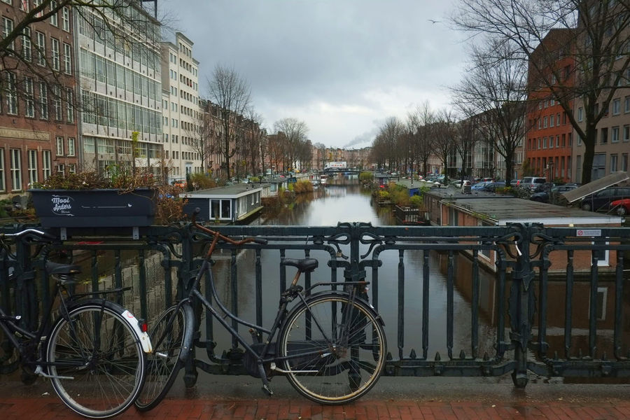 Taken just east of the downtown core of Amsterdam December 2017 Amsterdam Fashion Netherlands Winter Bicycle Building Exterior Built Structure Canal Canal Boat City Europe Holland House Boat No People Outdoors Sky Transportation