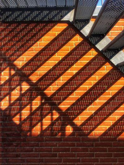 Low angle view of orange wall