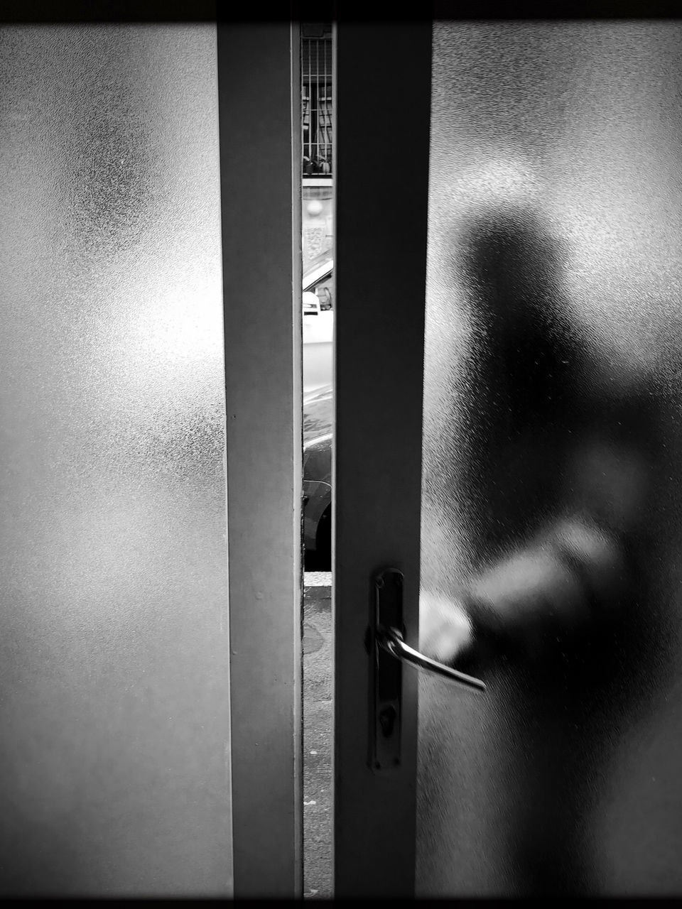 auto post production filter, entrance, door, indoors, transfer print, one person, real people, close-up, human body part, metal, human hand, day, handle, architecture, doorknob, security, wall - building feature, lifestyles