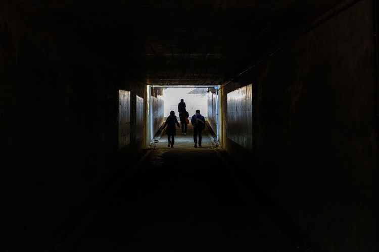 Group Of People Real People Architecture Men Silhouette Lifestyles Indoors  Leisure Activity Built Structure Walking People Tunnel Day Light At The End Of The Tunnel Dark Adult Women Rear View Copy Space