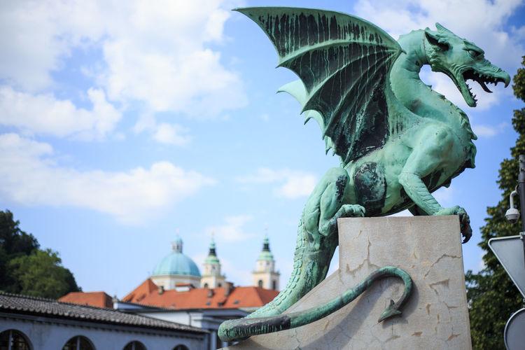 Dragon sculpture against sky