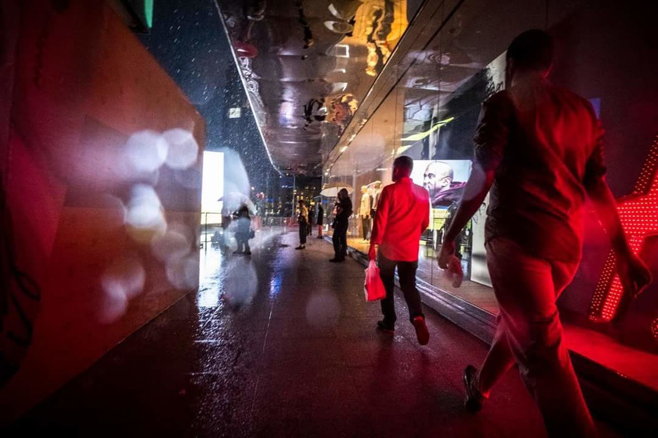 blurred motion, walking, city life, indoors, architecture, women, group of people, full length, illuminated, men, large group of people, real people, city, people, adult, day, adults only