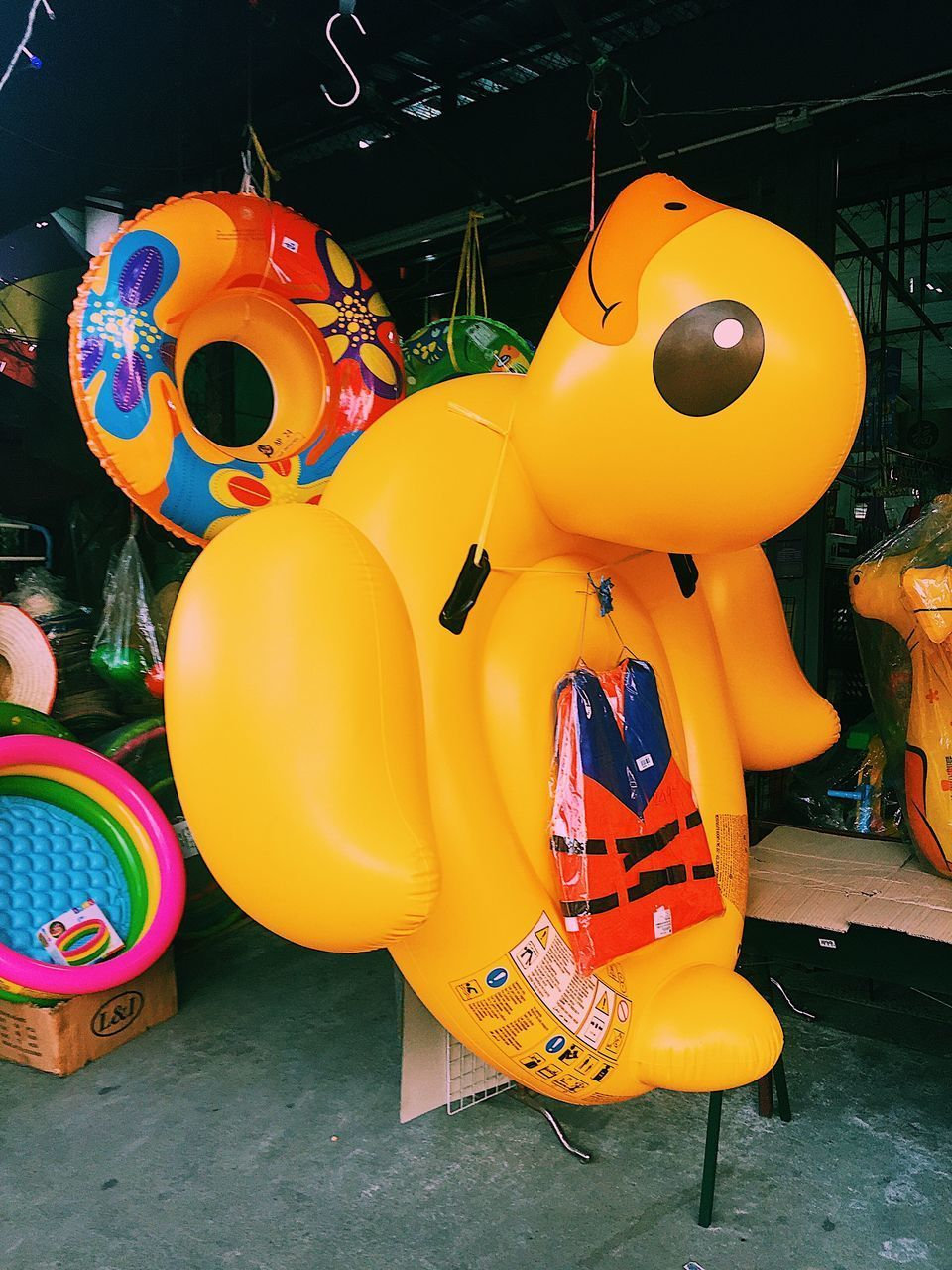 childhood, representation, multi colored, yellow, toy, plastic, large group of objects, day, inflatable, balloon, variation, choice, outdoors, retail, human representation, close-up, container, for sale, retail display