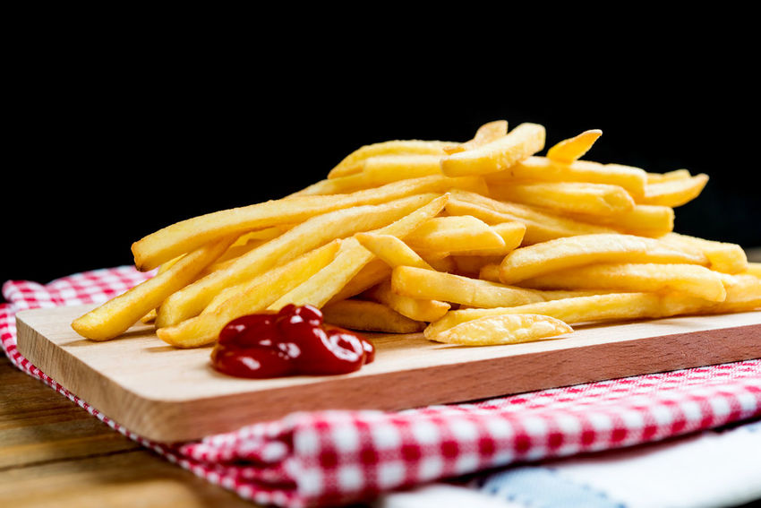 Dinner Lunch Black Background Close-up Cutting Board Day Deep Fried  Delicious Eating Healthy Fast Food Food Food And Drink French Fries Freshness Indoors  No People Potato Chip Prepared Potato Ready-to-eat Red Snack Studio Shot Unhealthy Eating Vegetable