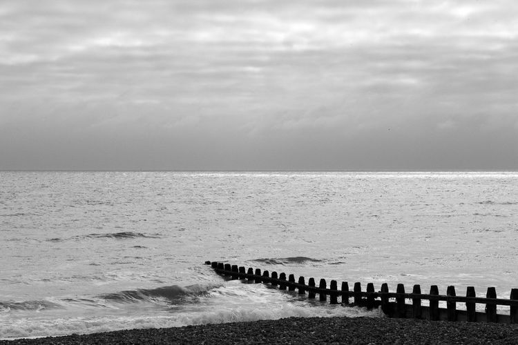 Distant Sunlight Black & White Distant Sunlight Beach Beauty In Nature Blackandwhite Cloud - Sky Groyne Horizon Over Water Nature Outdoors Sea Sky Tranquil Scene Tranquility Water