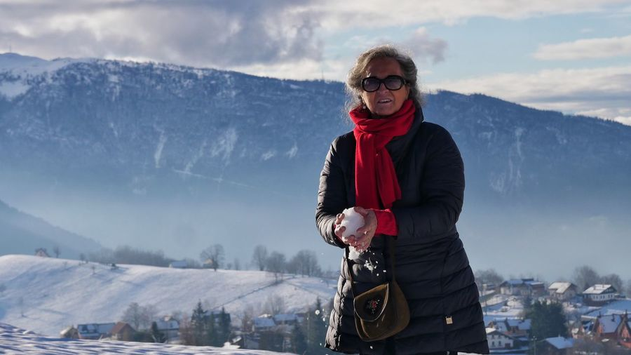 Portrait of smiling standing on snow covered mountain