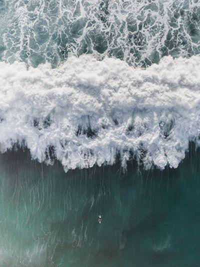 Aerial view of huge waves in sea