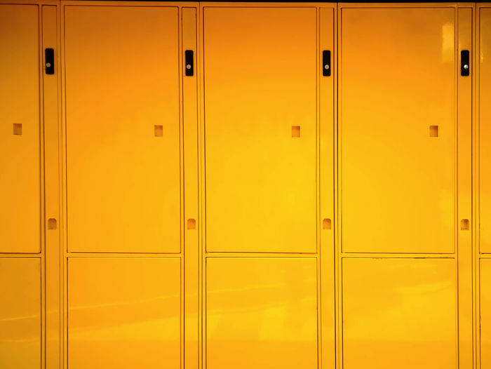 Full Frame Background of Glossy Vivid Yellow Lockers Locker Office Vivid Backgrounds Close-up Closed Color Day Door Full Frame Glossy Hinge Indoors  Lock Locker Locker Room No People Pattern Protection Safety School Security Yellow