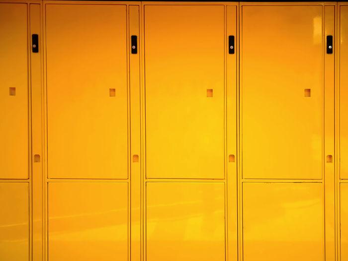 Full frame shot of yellow lockers