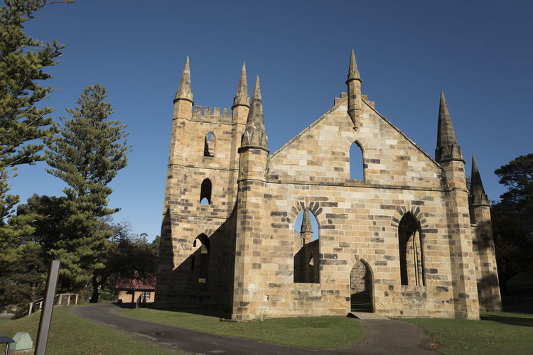 Shot in Tasmania, Australia. Architecture Bell Tower Building Exterior Built Structure Castle Clear Sky Day History Low Angle View No People Outdoors Place Of Worship Religion Sky Spirituality Sunlight Travel Destinations Tree