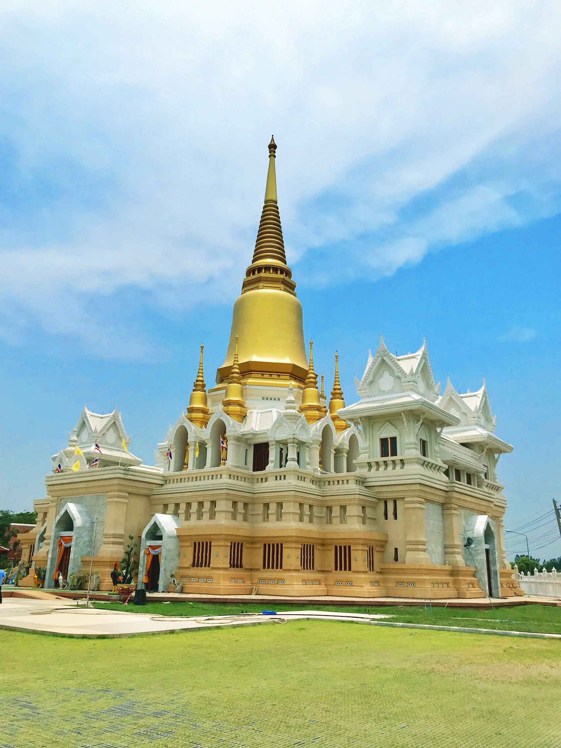 built structure, building exterior, architecture, sky, belief, religion, building, place of worship, grass, cloud - sky, spirituality, travel destinations, no people, gold colored, travel, nature, history, the past, spire, outdoors