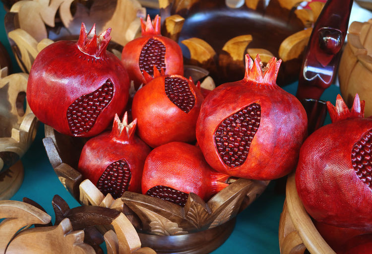 View of pomegranate in wooden container