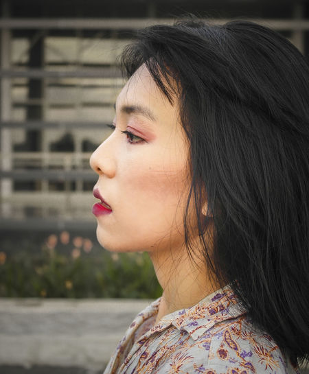 Close-up portrait of woman looking away