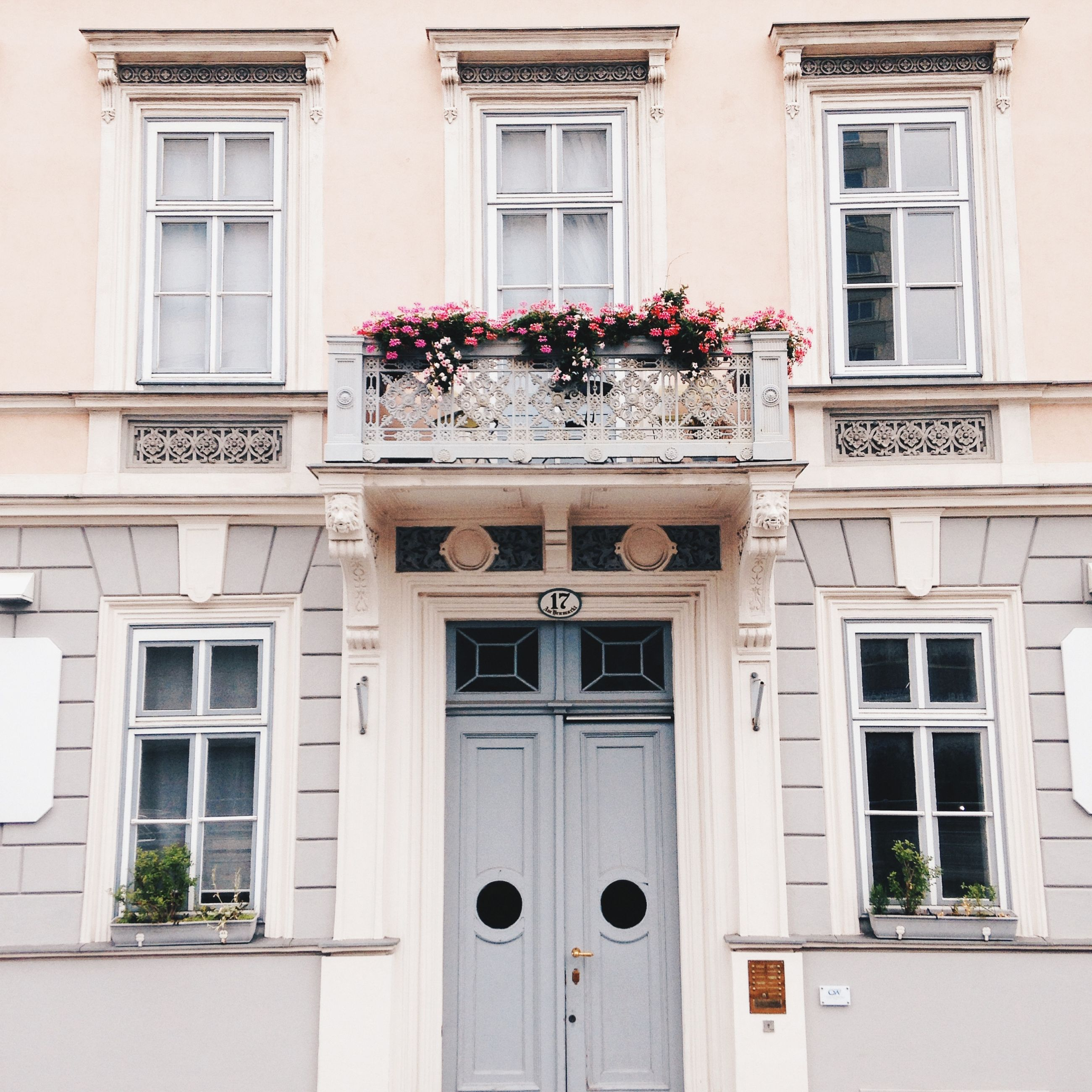 building exterior, architecture, built structure, window, residential building, residential structure, balcony, building, house, flower, facade, low angle view, glass - material, city, day, growth, outdoors, apartment, no people, door