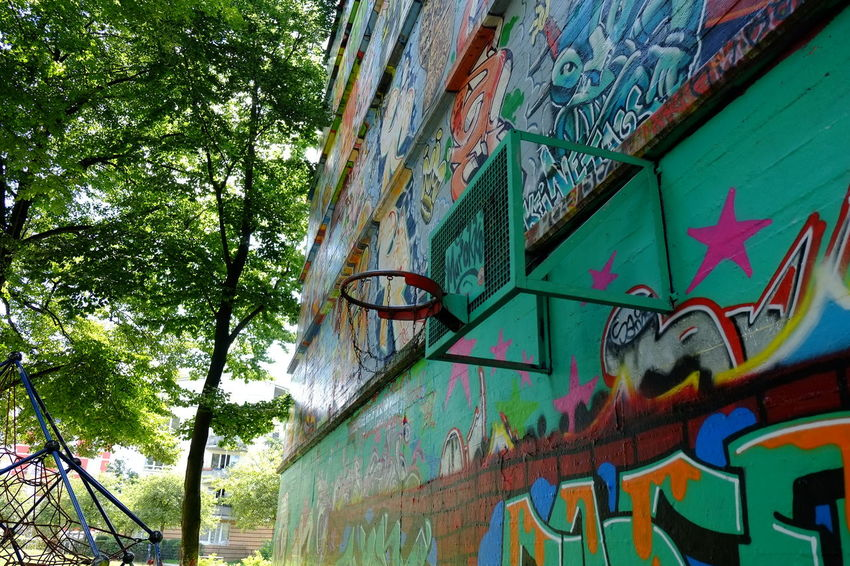 Architecture Art Art And Craft Basketball Bball Bball Game Building Exterior Built Structure Colorful Creativity Day Design Graffiti Growth Low Angle View Multi Colored No People Outdoors Railing Residential Building Street Streetart Text Tree Urban