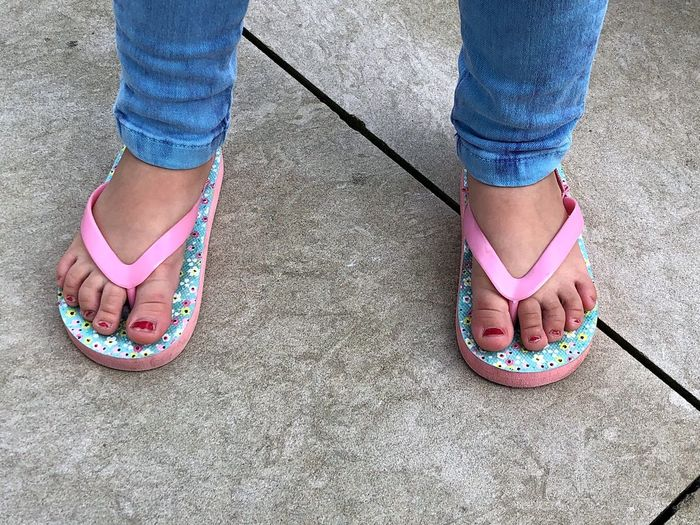 Feet Nails Nailpolish Flip Flops Low Section Shoe Human Leg Human Body Part Body Part Standing Childhood Child Girls Togetherness Lifestyles People Sandal Real People Casual Clothing Pink Color