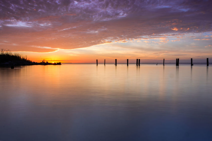 Atmosphere Atmospheric Mood Bridge Calm Lake Light Majestic Mid Distance Ocean Outdoors Pier Reflection Rippled River Sea Sky Sunset Tranquil Scene Tranquility Water Waterfront