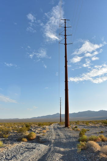 Electrical power poles and power lines along power line road in pahrump, nevada, usa