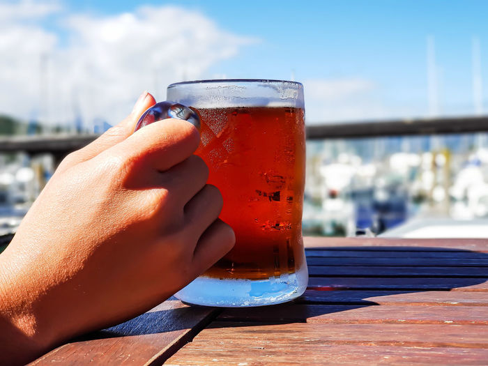 Midsection of person holding drink