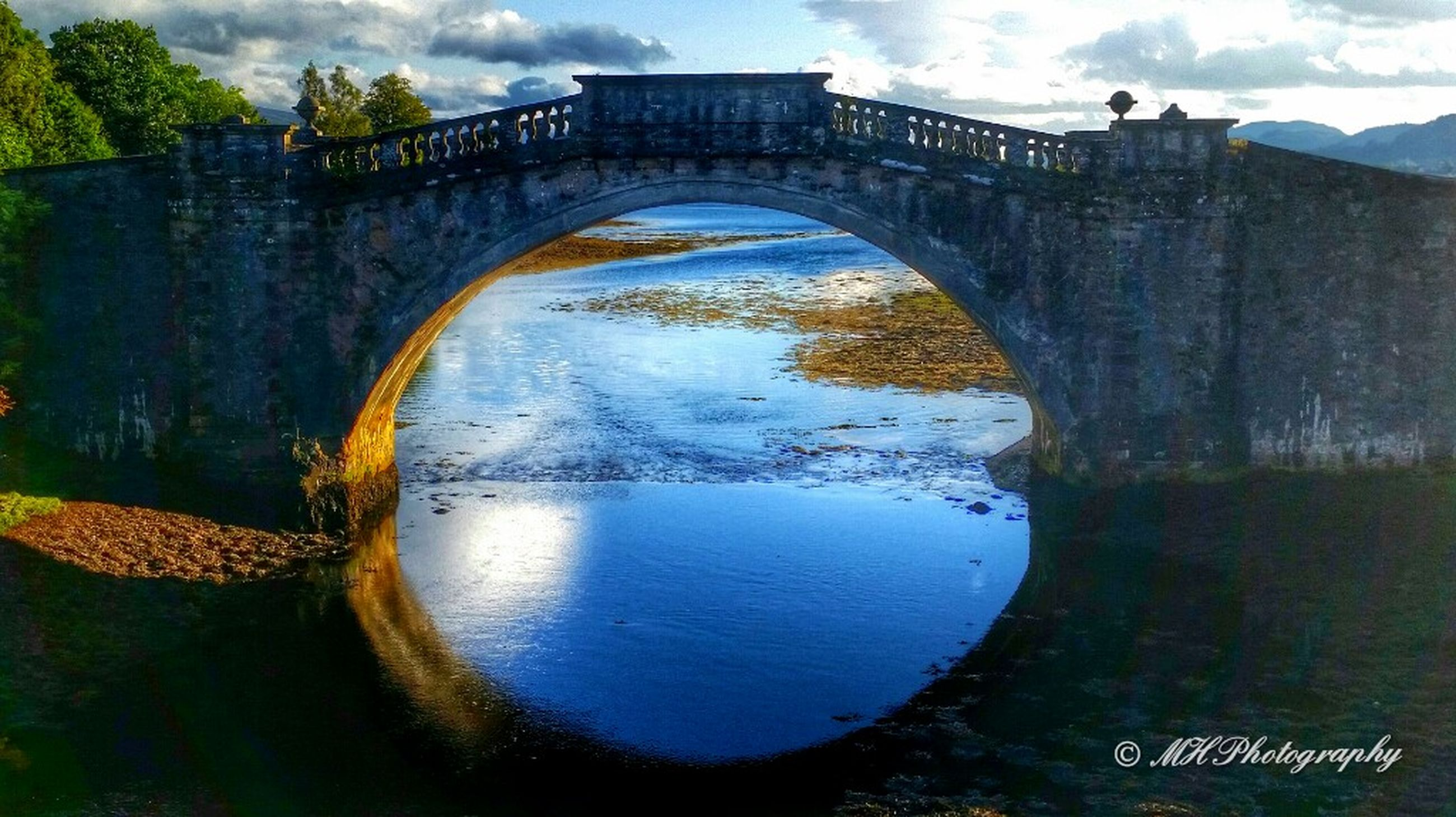 arch, built structure, architecture, water, bridge - man made structure, connection, arch bridge, sky, river, tree, reflection, cloud - sky, bridge, nature, day, tranquility, no people, outdoors, building exterior, canal