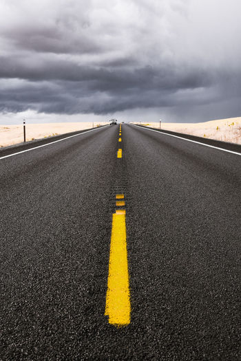 Bleached road trip Travel Looming Sky Moody Sky Road Markings USA Asphalt Bleached Cloud - Sky Day Diminishing Perspective Distance Nature No People Outdoors Road Road Marking Road Trip Scenics Sky Straight The Way Forward Transportation Vertical Yellow Marking Overcast vanishing point