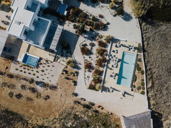 Aerial photo of a villa and pool in Greece Architecture Building Exterior Built Structure High Angle View Building City No People Day Residential District Tree Nature Town Outdoors Water Plant Car Aerial View House Land Mediterranean  Villa Pool Swimming Pool