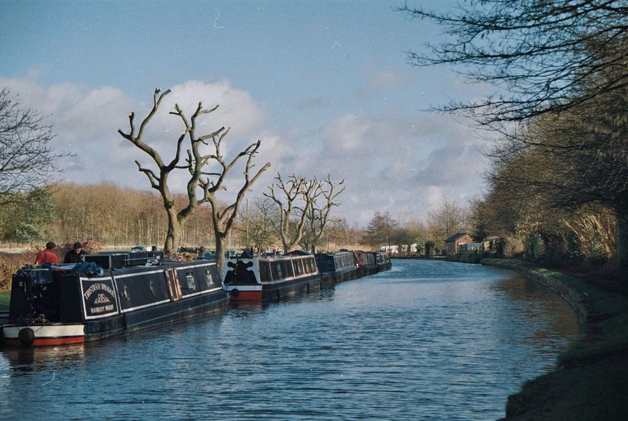 Shot using a 1970s Canon FTb 35mm film camera. Anderton Believeinfilm Filmisnotdead Film Photography Blue Sky Narrowboat Canal Bare Tree Tree Water River Waterfront Sky Nautical Vessel Branch Day Outdoors Transportation Riverbank