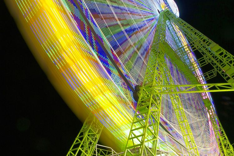 Multi Colored Black Background Night Illuminated Freshness Alicante City Nightlife Circle Low Angle View Ferris Wheel Amusement Park Light In The Darkness City Arts Culture And Entertainment Amusement Park Ride Fun Park - Man Made Space Turning Noria Noria, Feria Atraction Park Alicante People And Places Diversion Long Exposure