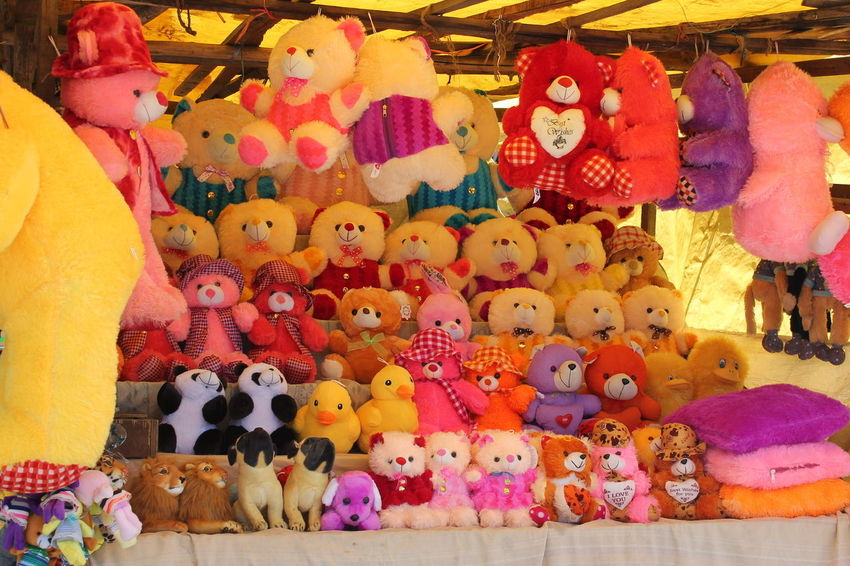 Just Colours. Shop in the Park. Abundance Arrangement Business Childhood Choice Collection For Sale Human Representation Large Group Of Objects Market Market Stall Multi Colored Order Representation Retail  Retail Display Sale Store Stuffed Toy Toy Variation