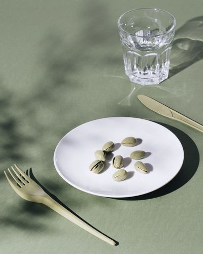 Close-up of pistachios in plate on table