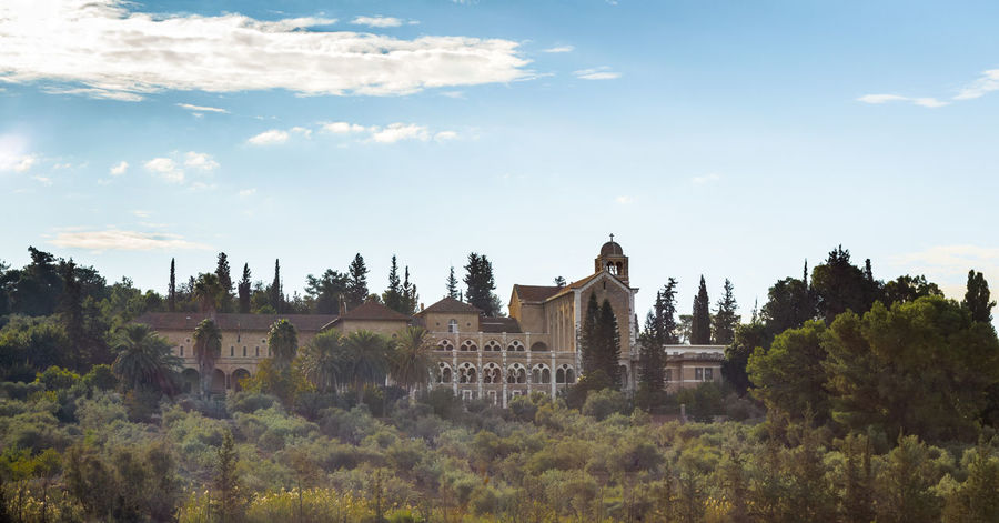 View of the monastery of the silent - Latrun early morning. It was founded in 1890. The building was built in 1927. Old Abbey Agriculture Architecture Christianity Church Faith Monastery Olive Architecture Culture Day Harmony History Israel Latrun Lifestyles Nature Religion Silence Silent Sky Trappist Tree Wine
