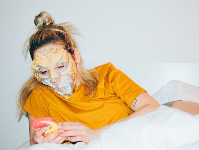 casually checking phone in mask Bed Face Mask Facemask Mobile Conversations Smart Smartphone Woman