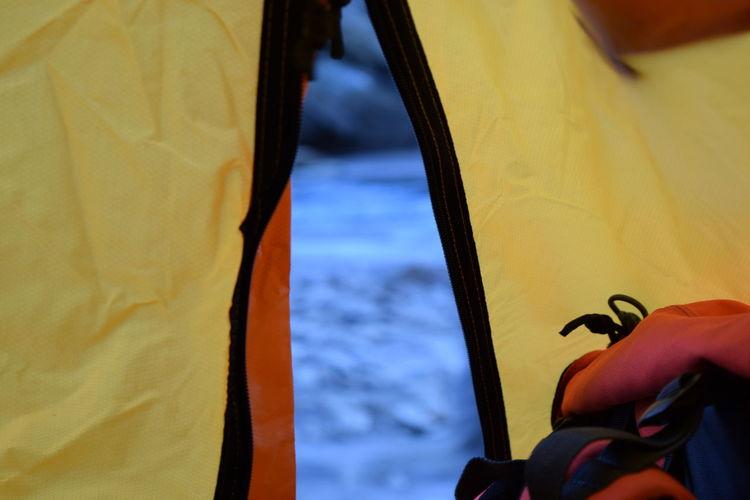 Field seen through tent entrance