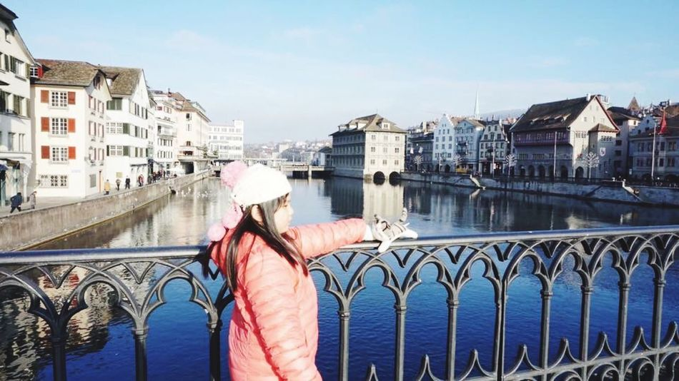 Lake View Lake Zürich Switzerland Traveling One Person City Tourist Travel Destinations Architecture Adults Only Railing Only Women Built Structure One Woman Only Bridge - Man Made Structure Building Exterior Outdoors Standing People Sky Girl Day Water Human Body Part